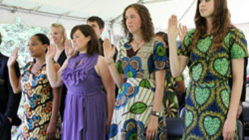 A section of the new American Peace Corps volunteers take their oathes at the residence of the US Ambassador, yesterday (Photo T.Kisambira)