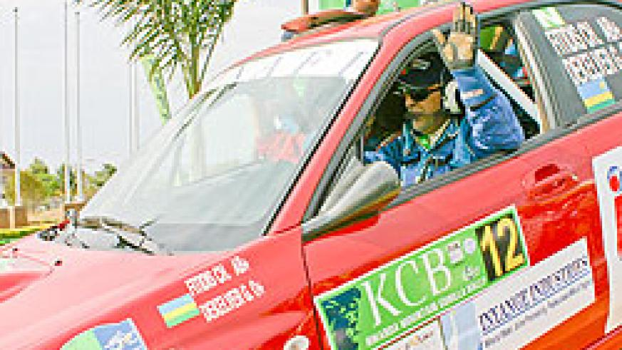 Fitidis waves to the crowd after being flagged off during the 2009 KCB Rwanda Mountain Gorilla Rally. (File photo)