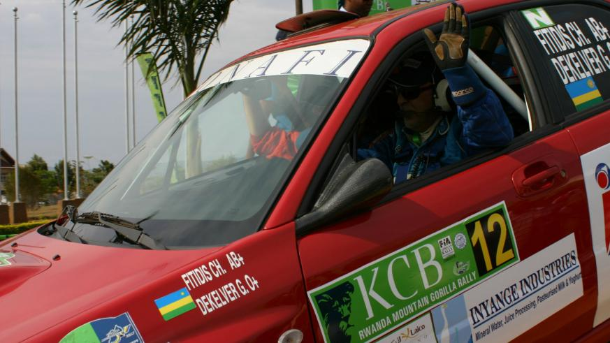 Fitidis waves to the crowd during the 2008 KCB Rwanda Mountain Goriila Rally. (File Photo)