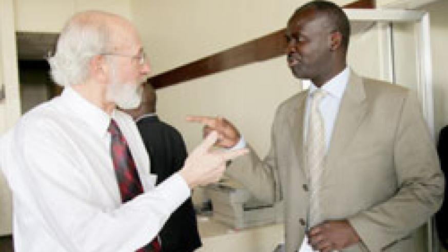 Dennis P. Garrity, the Director general of World Agroforestry Centre (L) chats with Stanislas Kamanzi, the minister of Minerals and forestry (T.Kisambira)