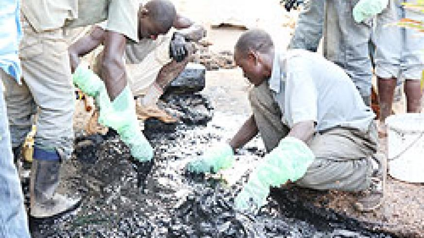 Volunteers separate Genocide victims' remains from waste at Remera-based Hotel Tech last week (File Photo)