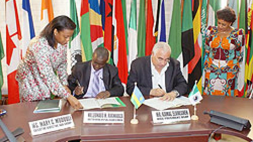 Top executives at AfDB sign the grant agreement to Rwanda (Courtesy Photo)