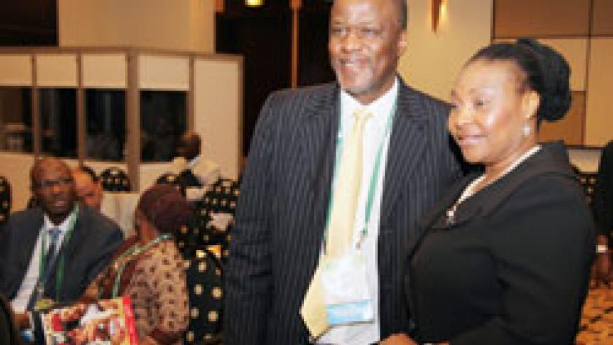 South African singer Yvonne Chakachaka (R) with a delegate at the sanitation conference yesterday (Photo T Kisambira)