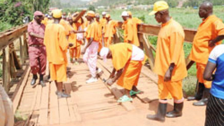 Prisoners working on a Bridge. The Prisons service projects to reap more from the inmates' economic activities (File Photo)