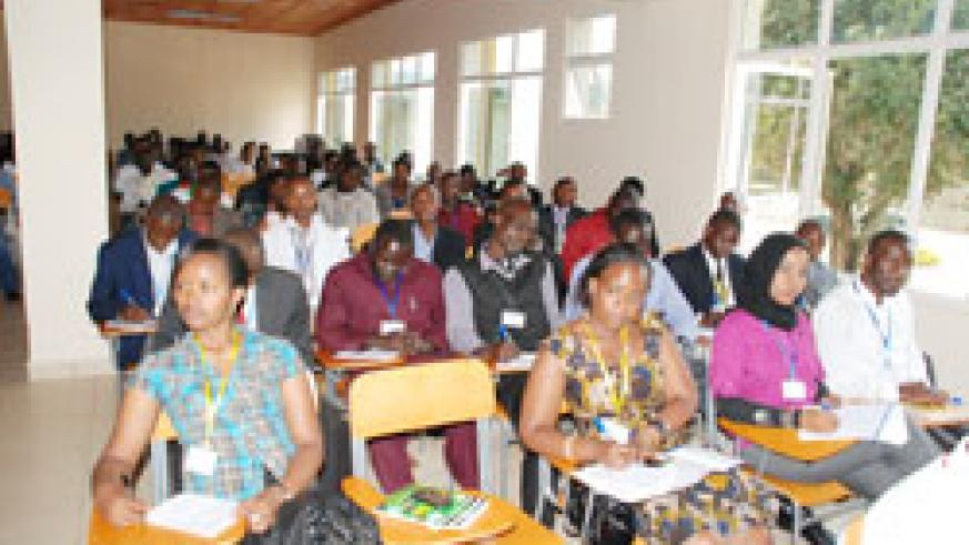 Students from the East African Community Students' Union take notes during the conference. (Courtesy photo)