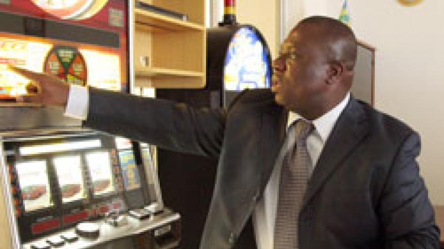 Philippe Brizoua, the head of Rwanda Gaming Corporation points at a slot machine. (File Photo)
