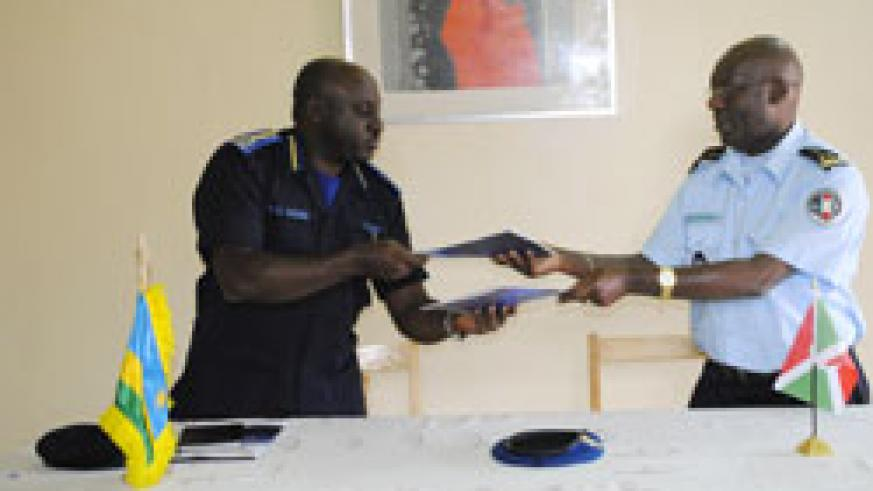Police chiefs exchange files after their meeting in Ngozi, Burundi (Courtsey Photo)