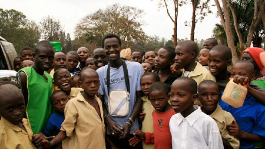 Sylvain with Rwandan children in the countryside.