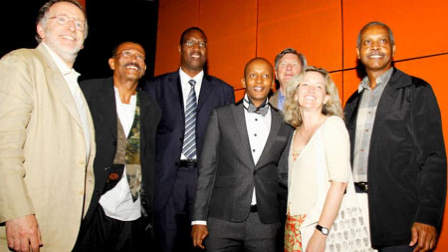 (L-R) Phil Alden Robinson, Wynn Thomas Protais Mitali the Minister of Youth Culture and Sports, Eric Kabera CEO of RCC, Ellen Harrington and Willie Burton during the official opening of the 7th edition of the Rwanda Film Festival, on Saturday.
