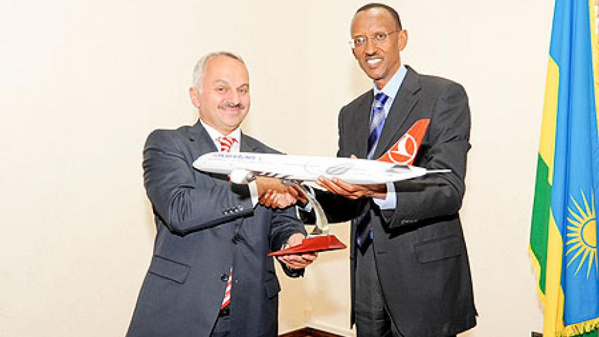 President Paul Kagame with the chief executive of Turkish Airlines, Temel Kotil, hold a model plane after  their meeting at Village Urugwiro yesterday. The New Times /Village Urugwiro