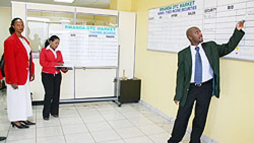 Stockbrokers during a trading session on the floor of the Rwanda Stock Exchange. Such businesses were not provided for under the VAT law. The New Times /File Photo