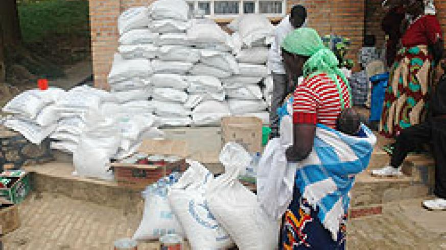 Food items being distributed at a transit camp. WFP has warned of a food crisis if it fails to get funds. The New Times File