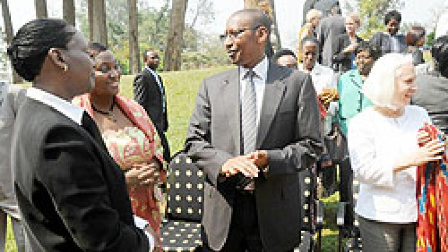 Finance Minister John Rwangombwa (C) chats with Diana Ofwona (L) of UN Women Rwanda and Victoria Akyeampong, the UNFPA Representative to Rwanda, during the Gender Budgeting conference, yesterday. The New Times/John Mbanda