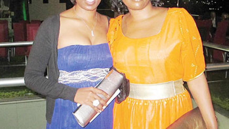 Actress Cleophas Kabasiita (L) accompanied by a friend during the premiere of the documentary film Kinyarwanda at The Manor Hotel, Kigali yesterday. The New Times / John Mbanda.