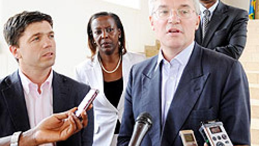 The UK Secretary of State for International Development, Andrew Mitchell, (R) speaks to reporters after meeting President Kagame at Village Urugwiro, yesterday. Looking on is Steven Crabb MP (L), the Minister of Foreign Affairs, Louise Mushikiwabo (c) and