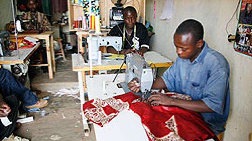 Tailors in one of many Kigali shops. Rwanda has been hailed for ratifying Labour conventions. The New Times File.