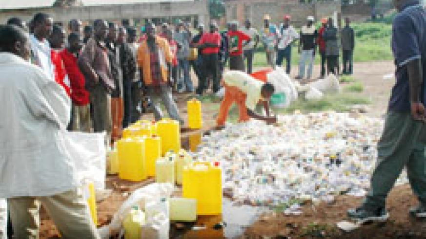 Illegal brew being destroyed in a past event; Rubavu authorities have sounded concern over the growing use of such illicit liquor in the area. The New Times / File.