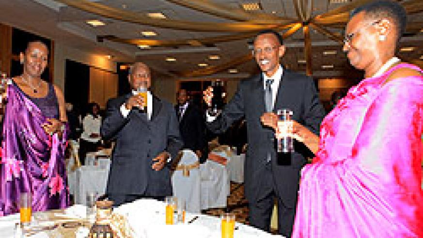 Presidents Paul Kagame and Yoweri Museveni together with the First Ladies at Kigali Serena Hotel, last Sunday.