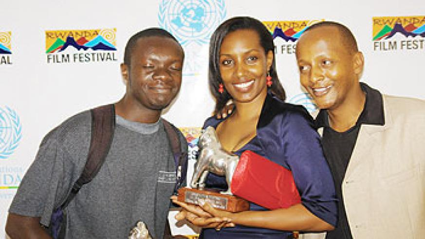 (R-L) Eric Kabera, Cleophas Kabasita and Jean Baptiste Minani  pose with their awards. The New Times/A. Ndungutse.