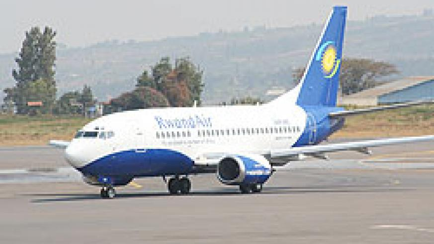 A RwandAir plane on a Kigali International Airport runway. Then New TImes/ Courtesy
