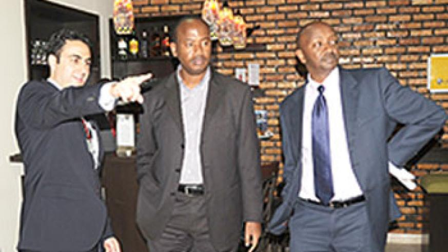 The CEO of the National Aviation Services (NAS) Hassan  El-Houry (L) shows the Minister of Infrastructure Albert Nsengiyumva around the newly opened VIP Lounge as Civil Aviation Authority Chief Richard Masozera looks on.The New Times /John Mbanda.