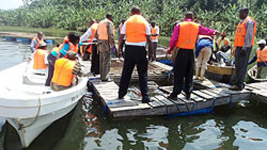 Fishery officials and fishermen harvest fish from floating cages  in Lake Ruhondo recently. The New Times File