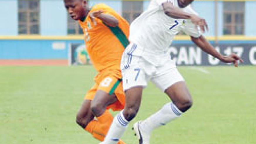 Charles Tibingana (R) fights for the ball with an Ivory Coast player during the 2011 Africa Junior Championship. The Uganda based winger has been called to the senior team. The New Times / file