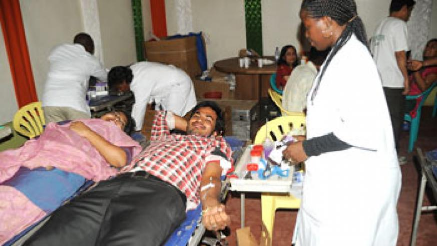 An Indian couple living in Rwanda donating blood on Saturday. The New Times /file.