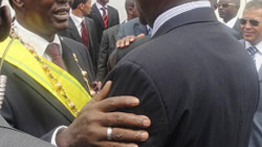 Prime Minister Makuza congratulates Chad President Idriss Deby after the swearing in ceremony, yesterday. The New Times /Courtesy