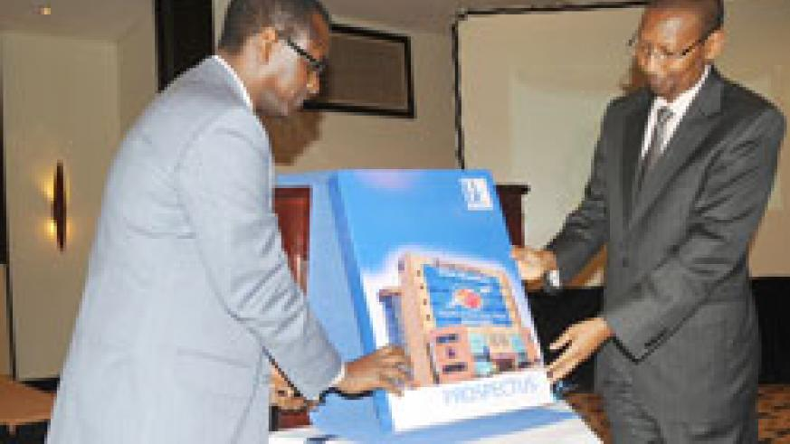 BK Managing Director James Gatera (L) and Finance Minister John Rwangombwa at the launch of the Bank's IPO in June this year. The New Times /File.