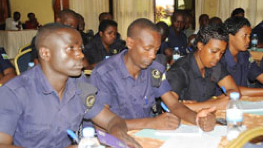 Police officers take notes during a training worshop in the past. The New Times /File.