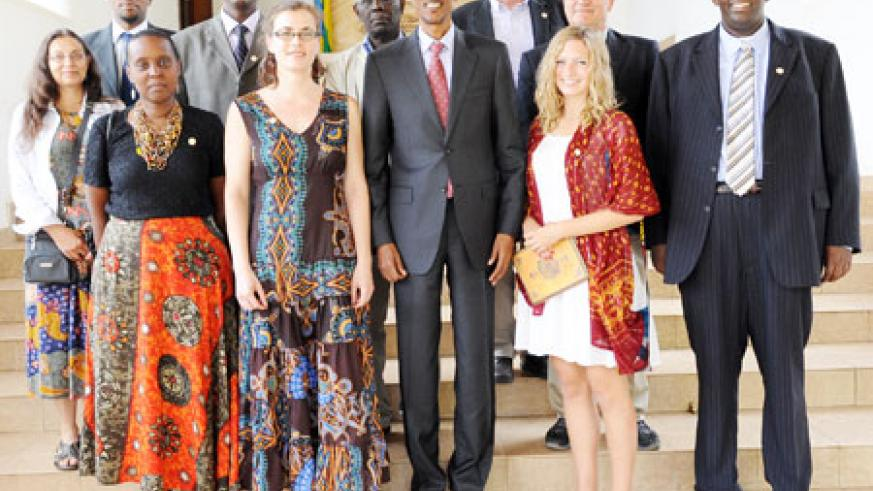 Kagame with the Genocide scholars after their meeting at Village Urugwiro yesterday. The New Times /Village Urugwiro.