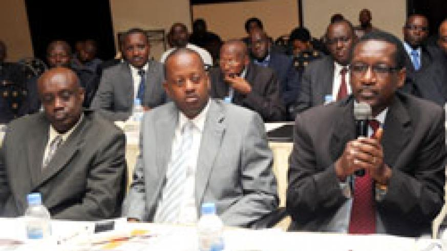 BK Managing Director James Gatera (R) speaks at the monetary policy statement meeting as his counterparts Jack Kayonga (C) of BRD and Geoffrey Byegeka of CSS look on. The New Times /John Mbanda.