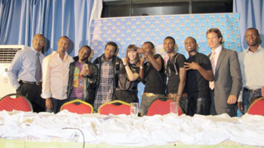 PGGSS organising team and the artistes pose for a photo during the event. The New Times /M. Linda