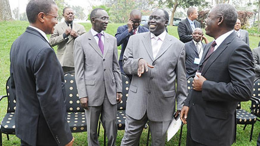 Justice Minister Tharcisse Karugarama (2nd right) shares a light moment with  Deputy Chief Justice Sam Rugege (2nd left), Uganda's Director of Public Prosecutions, Richard Buteera (L) and his Deputy Amos Ngolobe at the Africa Prosecutors' Association conf