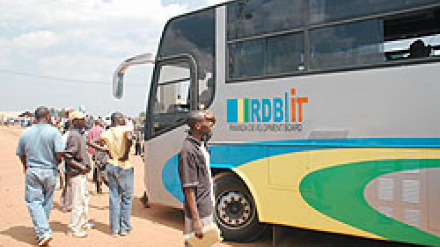 Residents of Gicumbi admire one of RDB's ICT Buses. Gicumbi residents have fully embraced ICT. The New Times File.