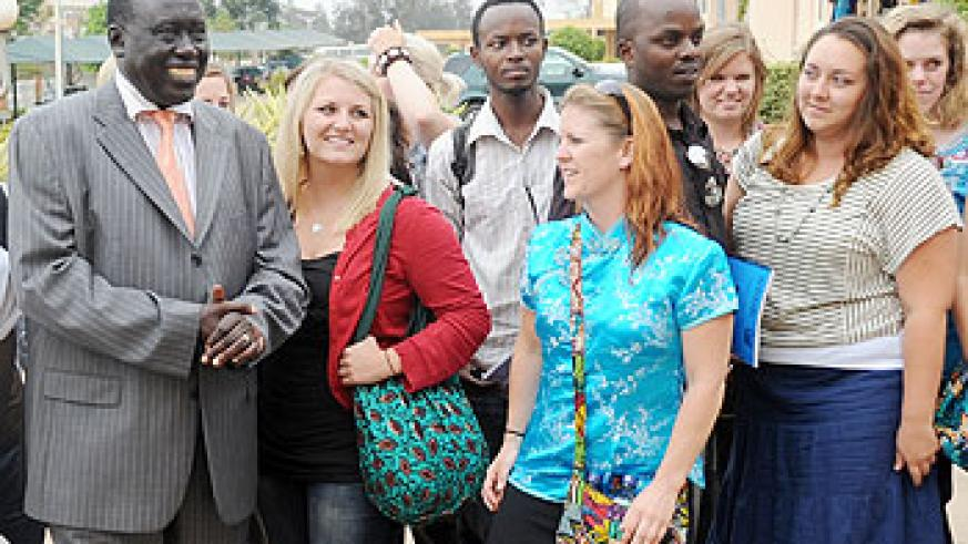 Justice Minister Tharcise Karugarama (L) with the students from Global Youth Connect yesterday. The New Times John Mbanda.