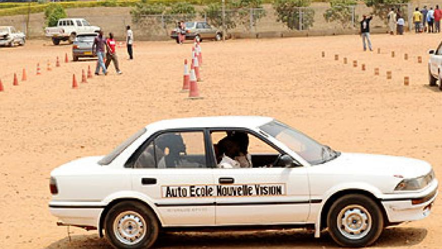 Learners undergo practical driving lessons near the Amahoro National Stadium; The traffic police has introduced an e-registration system  for driving tests. The New Times/ File Photo.
