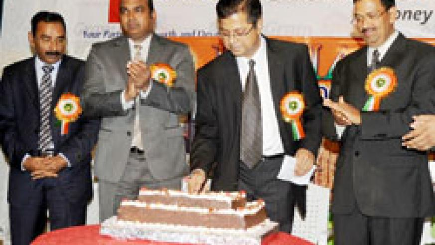 The Chairman of the Indian Community Association of Rwanda, Dinesh Kalyan (2nd Right), cuts a cake as he leads the Indian community to mark India's 65th Independence Day in Kigali yesterday. The New Times/John Mbanda