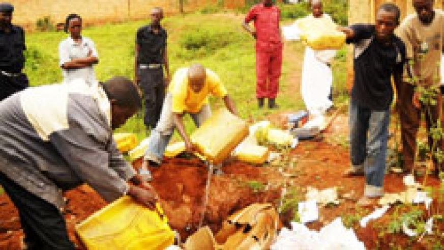 Kabarondo police supervise the destruction of illicit brew popularly known as Kanyanga that was impounded from traffickers recently.The New Times /File