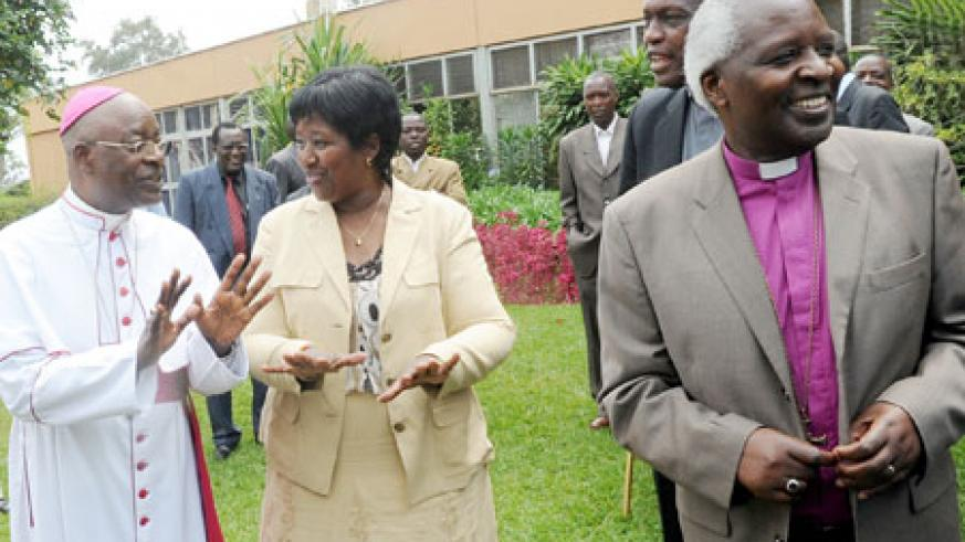 Health Minister, Dr. Agnes Binagwaho (2Left) , with religious heads; Archbishops Thaddee Ntihinyurwa and Onesphore Rwaje, during the fifth annual general assembly of Rwanda Interfaith Network against HIV/AIDS yesterday. The New Times/John Mbanda