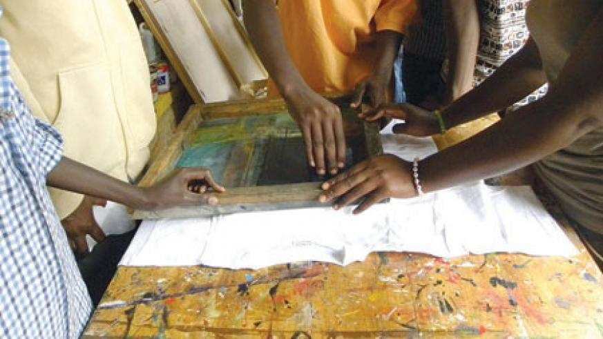 Hard working hands. Children making prints on a T-shirt.