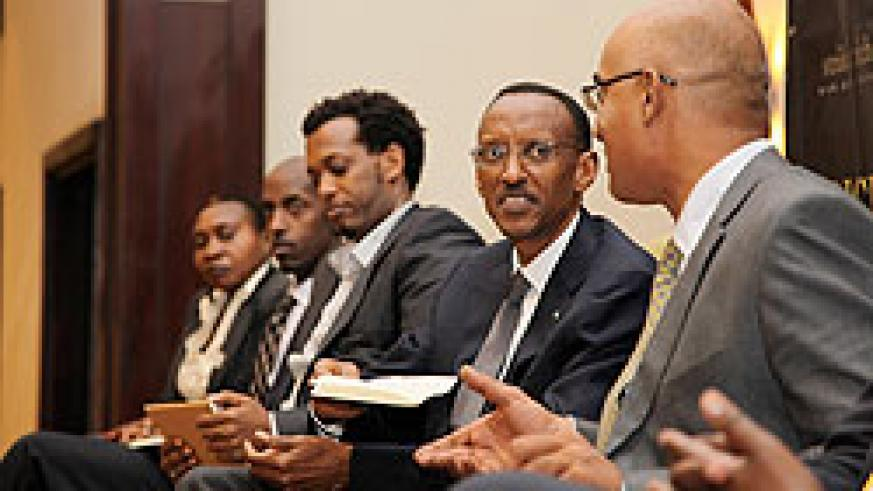 Mindspeak host, Ally-Khan Satchu (R), chats with President Kagame during the show yesterday in Kigali. Other panelists included (L-R), Alphonsine Niyigena - PSF, Albert Kinuma -MTN Rwanda and Amin Gafaranga ,a local entrepreneur.