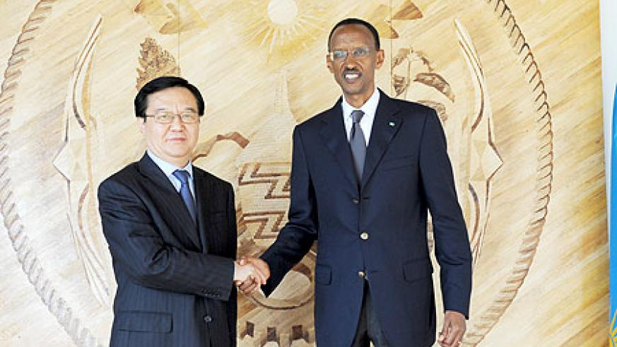 President Kagame receiving China's deputy Minister for Commerce, Gao Hucheng, yesterday. The New Times /Village Urugwiro