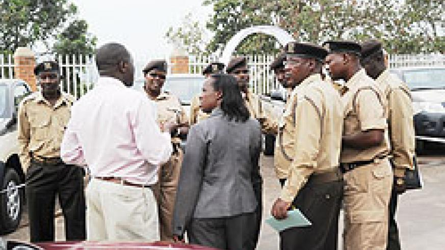 Prisons Directors in consultation after a recent meeting. Prison staff will sign performance contracts at the end of the month. The New Times/ File Photo