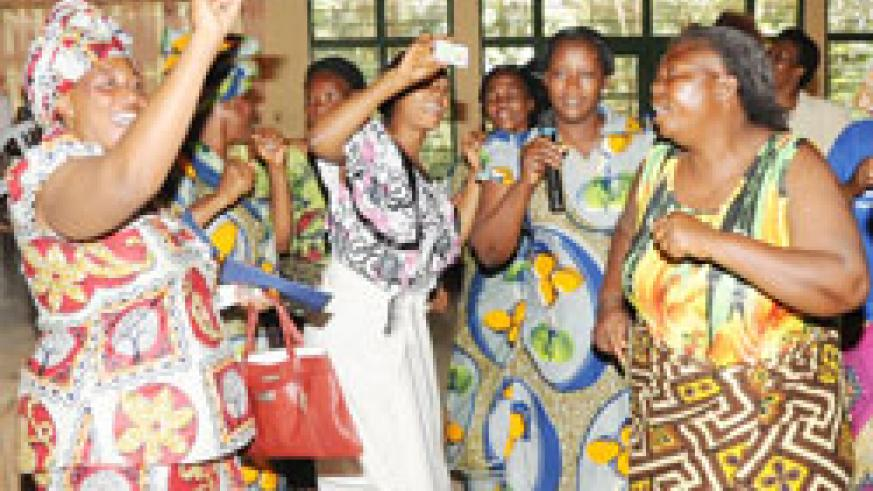 Congolese women celebrate after recieving  refugee identity cards in May last year. The New Times /File phot