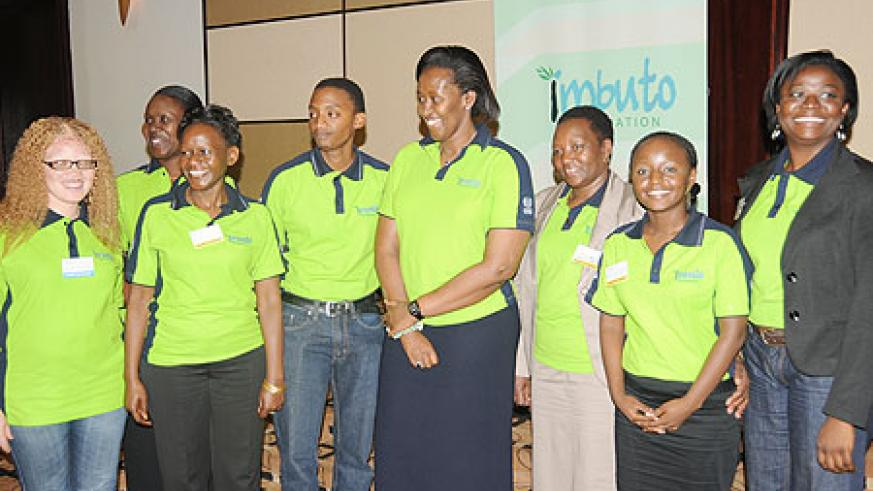 First Lady, Jeannette Kagame (C)  with youth from across Africa during the openning of the youth forum in Kigali, yesterday. The New Times/ John Mbanda.