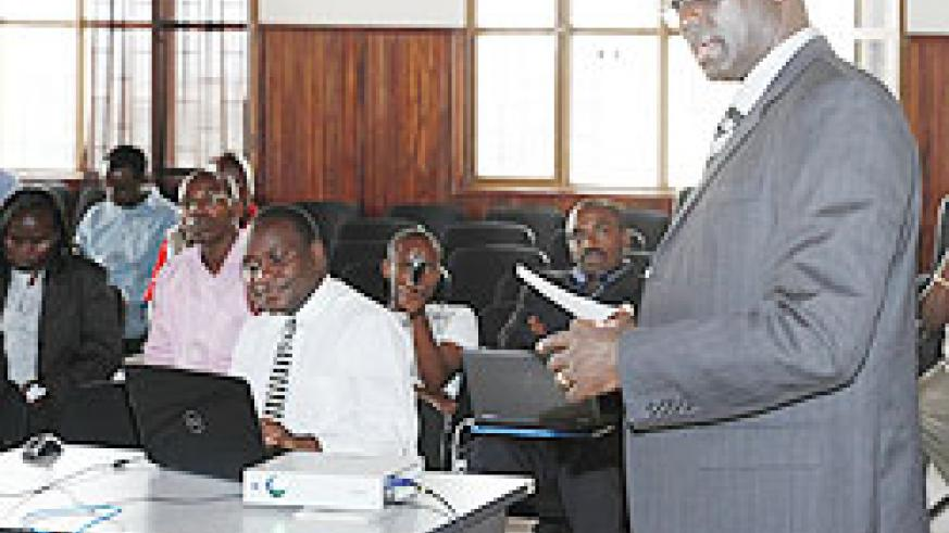 High Court President, Johnston Busingye during, the stakeholders' meeting on the new e-filing system. yesterday. The New Times/ Timothy Kisambira.