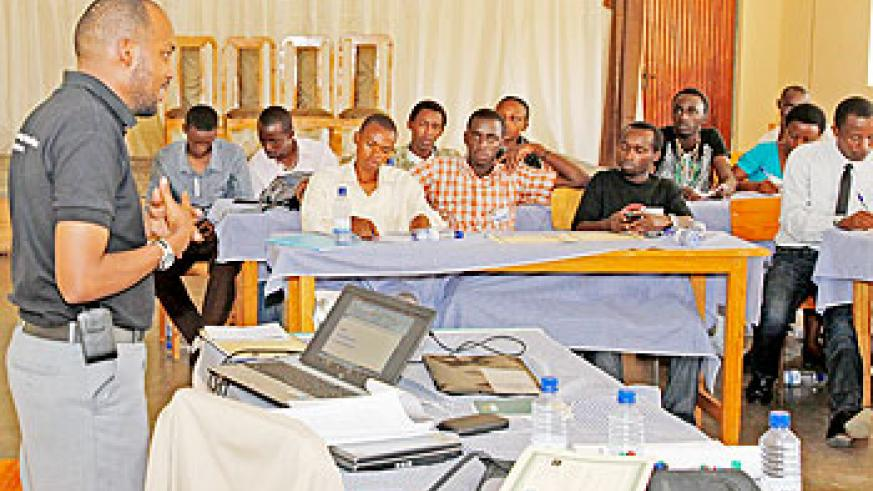 Dr.Joseph Nkurunziza talks to youths during the workshop. The New Times /Timothy Kisambira
