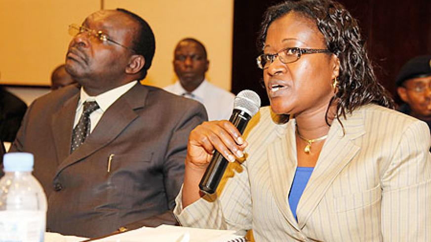 The Minister for EAC Affairs,Monique Mukaruliza (R) addreses the validation meeting as Minister Kanimba of Trade and Industry, looks on. The New Times/Timothy Kisambira